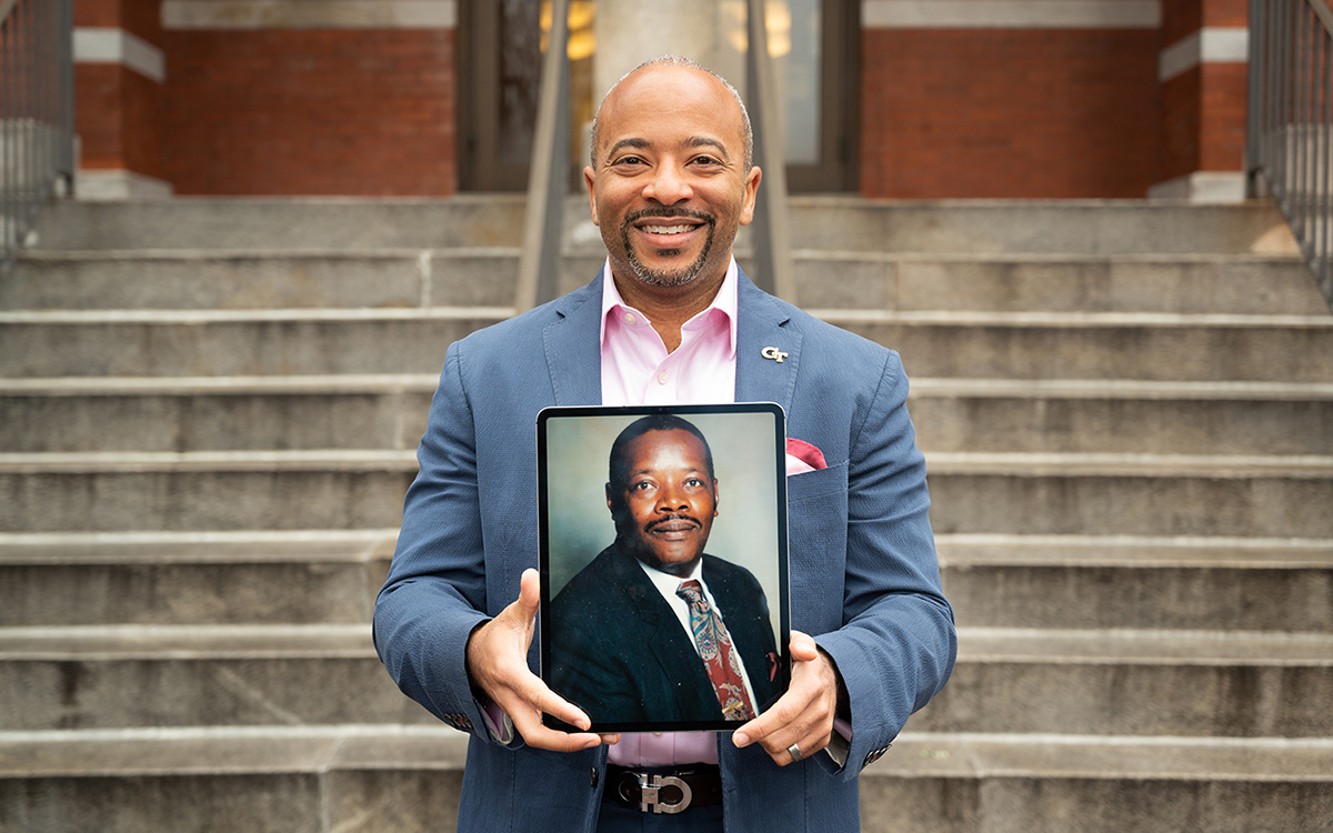 Dean Raheem Beyah holding a picture of his mentor Samuel Hill.