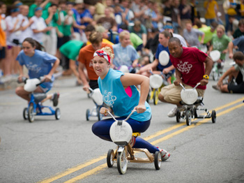 Students participate in Mini 500 tricycle race during Homecoming week.