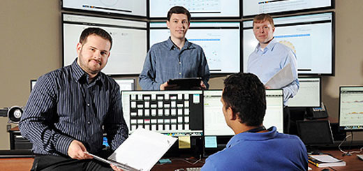 computer experts discussing cyber attacks